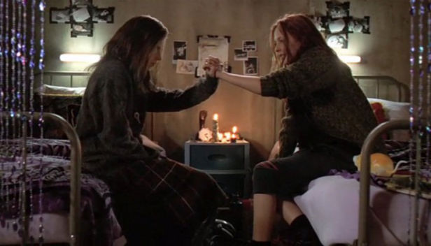 Emily Perkins and Katharine Isabelle making a pact in Ginger Snaps