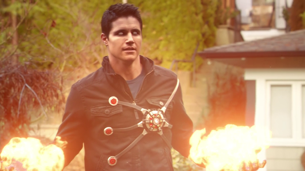 Firestorm approaching his classic superhero look by degrees