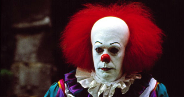 Tim Curry as Pennywise in the 1990 miniseries version of Stephen King's It