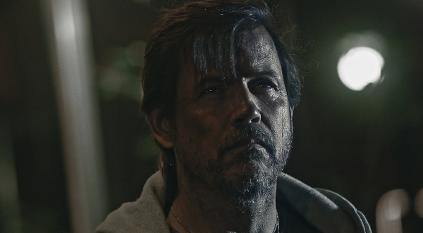 Michael Pare is having a bad night in The Shelter