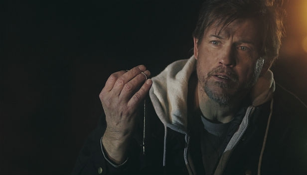 Michael Pare as Thomas in The Shelter