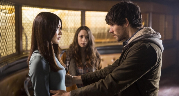 Leo (Colin Morgan) holding Anita (Gemma Chan) and Mattie (Lucy Carless) in the background.