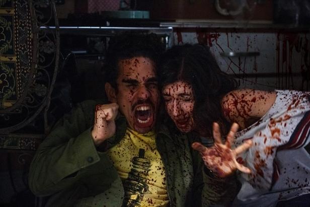 Pablo (Ray Santiago) and Kelly (Dana DeLorenzo) take cover