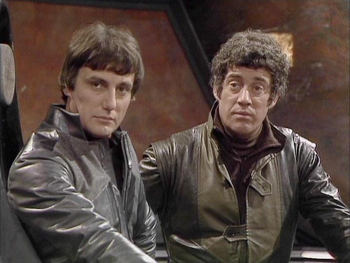 Paul Darrow as Avon and Gareth Thomas as Roj
