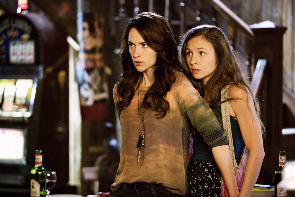 """WYNONNA EARP -- """"Keep the Home Fires Burning"""" Episode 102 -- Pictured: (l-r) Melanie Scrofano as Wynonna Earp, Dominique Provost-Chalkley as Waverly Earp -- (Photo by: Michelle Faye/Syfy/Wynonna Earp Productions)"""