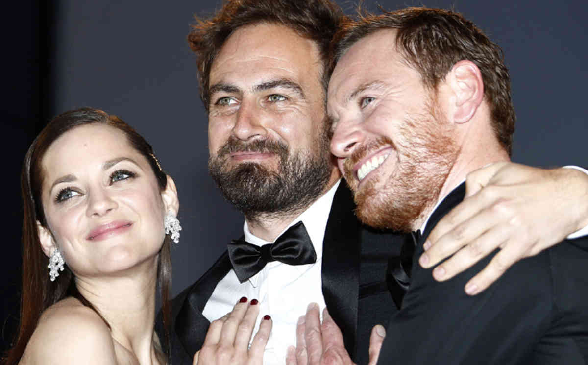 epa04764216 (L-R) French actress Marion Cotillard, Australian director Justin Kurzel and Irish-German actor Michael Fassbender leave the screening of 'Macbeth' during the 68th annual Cannes Film Festival, in Cannes, France, 23 May 2015. The movie was presented in the Official Competition of the festival which runs from 13 to 24 May.  EPA/IAN LANGSDON