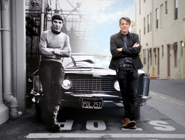 Adam Nimoy (right) re-creates his father (Leonard Nimoy)'s iconic pose with the family Buick Riviera. Leonard was photographed in 1966 while shooting Star Trek: The Original Series at Paramount Studios, while Adam traced his father's footsteps on the same lot in 2015 during the production of For The Love Of Spock. (Archive photo courtesy Nimoy Archive / CBS, Modern photo & artwork courtesy Kai de Mello / 455 Films)