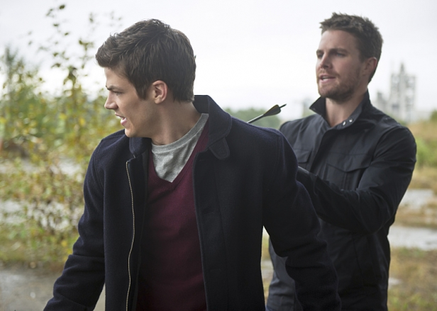 "The Flash -- ""Flash vs. Arrow"" -- Image FLA108b_0147b -- Pictured (L-R): Grant Gustin as Barry Allen and Stephen Amell as Oliver Queen -- Photo: Diyah Pera/The CW -- © 2014 The CW Network, LLC. All rights reserved."