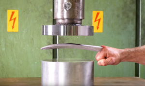 Logan's adamantium claws pay a visit to the Hydraulic Press channel