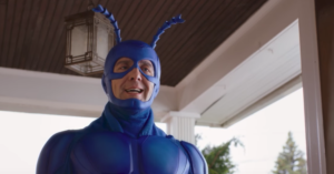 The Tick trailer is finally here, Peter Serafinowicz steps into the suit